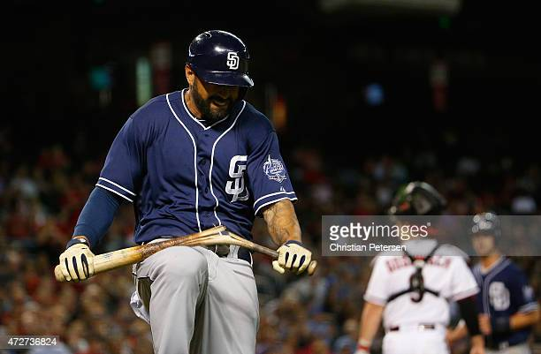 Matt Kemp of the San Diego Padres breaks a bat over his knee after a foul ball out against the Arizona Diamondbacks during the sixth inning of the...