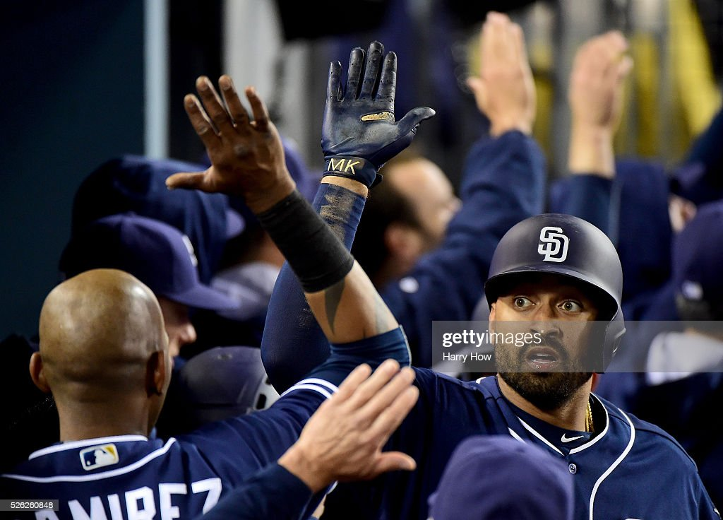 Matt Kemp #27 of the San Diego Padres celebrates his three run homerun with Alexei Ramirez #10 to take a 4-1 lead over the Los Angeles Dodgers during the eighth inning at Dodger Stadium on April 29, 2016 in Los Angeles, California.