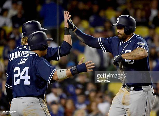 Matt Kemp of the San Diego Padres celebrates his three run homerun with Jon Jay and Travis Jankowski to take a 41 lead over the Los Angeles Dodgers...