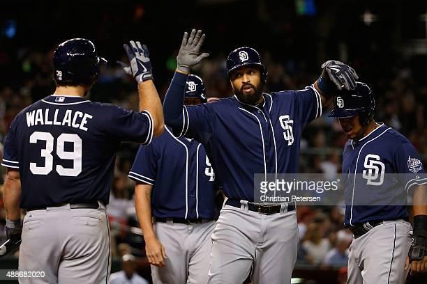 Matt Kemp of the San Diego Padres high fives Brett Wallace Wil Myers and Yangervis Solarte after Kemp hit a threerun home run against the Arizona...