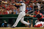 Matt Kemp of the San Diego Padres hits a three run home run against the Washington Nationals during the fifth inning at Nationals Park on July 22...