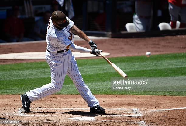 Matt Kemp of the San Diego Padres hits a threerun home run during the first inning of a baseball game against the Cincinnati Reds at Petco Park...