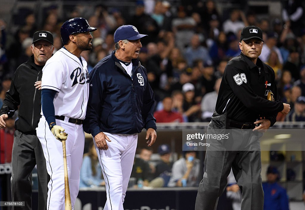 Matt Kemp of the San Diego Padres left and Bud Black center argue as they are both ejected from the the game by umpire Dan Iossogna right during the...