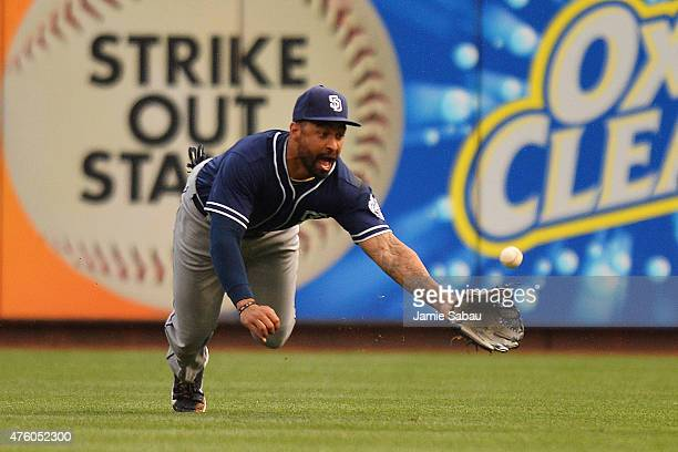 Matt Kemp of the San Diego Padres makes a diving catch for the third out in the third inning on a short fly ball hit by Todd Frazier of the...