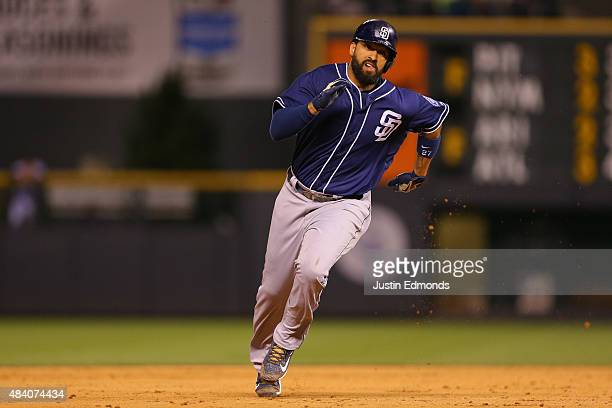 Matt Kemp of the San Diego Padres runs to third to complete the cycle during the ninth inning against the Colorado Rockies at Coors Field on August...