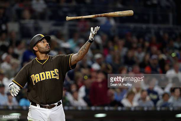 Matt Kemp of the San Diego Padres throws his bat after striking out during the fifth inning of a baseball game against the Washington Nationals at...