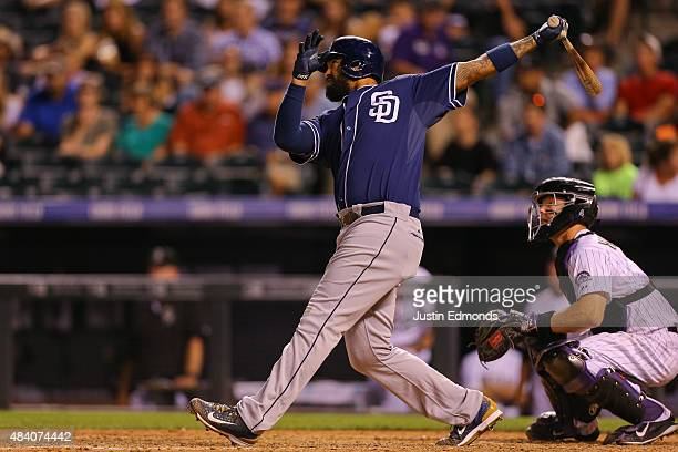 Matt Kemp of the San Diego Padres watches his RBI triple to complete the cycle during the ninth inning against the Colorado Rockies at Coors Field on...