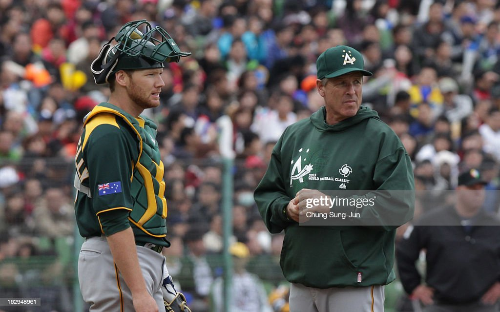 Matt Kennelly of Australia talks with coach in the third inning during the World Baseball Classic First Round Group B match between Australia and Chinese Taipei at Intercontinental Baseball Stadium on March 2, 2013 in Taichung, Taiwan.