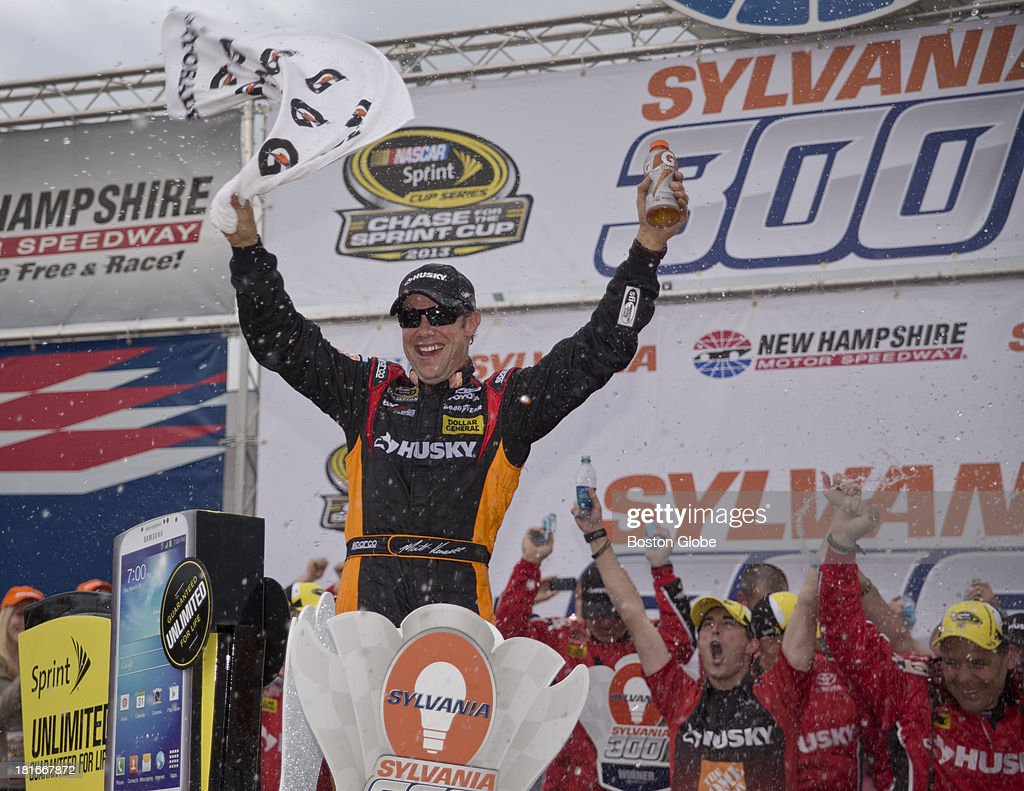 Matt Kenseth climbs out of his car in Victory Lane after winning the Sylvania 300. The NASCAR Sprint Cup series Sylvania 300 took place at the New Hampshire Motor Speedway, Sunday, Sept. 22, 2013.