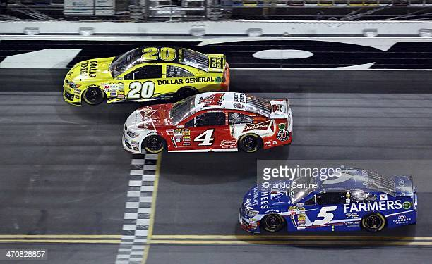 Matt Kenseth crosses the startfinish line to win the first race of the twin Budweiser Duel with Kevin Harvick in 2nd and Kasy Kahne in the 3rd at...