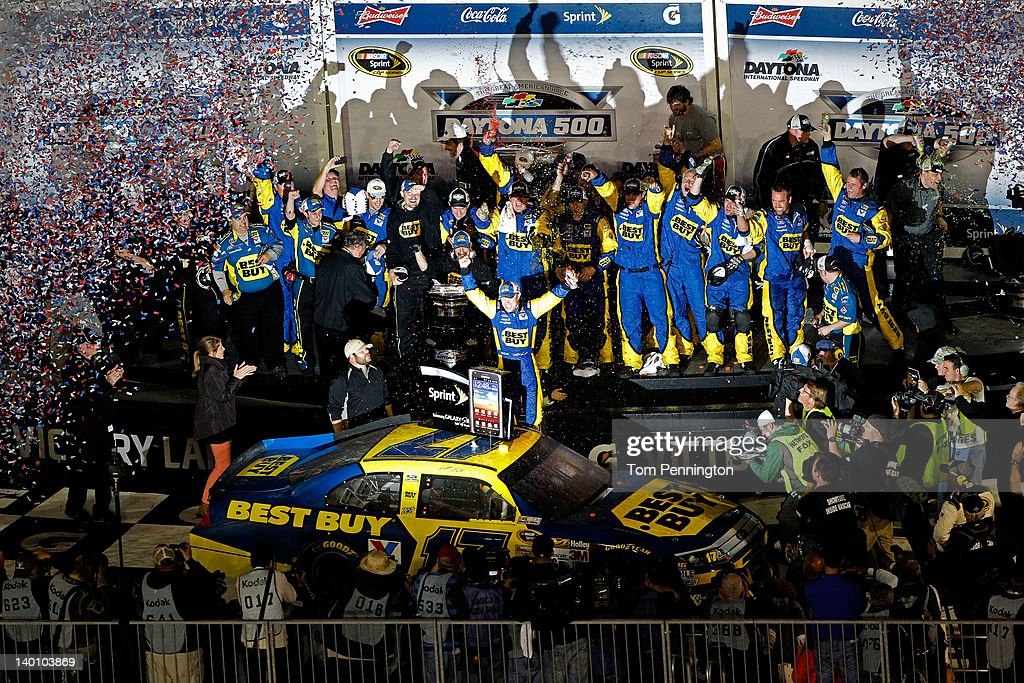 Matt Kenseth driver of the Best Buy Ford celebrates in Victory Lane after winning the NASCAR Sprint Cup Series Daytona 500 at Daytona International...