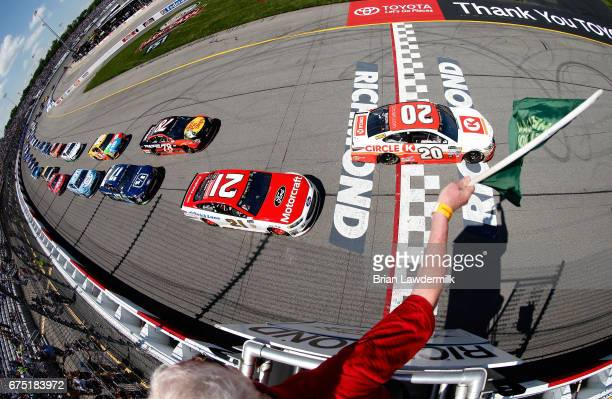 Matt Kenseth driver of the Circle K Toyota and Ryan Blaney driver of the Motorcraft/Quick Lane Tire Auto Center Ford take the green flag to start the...
