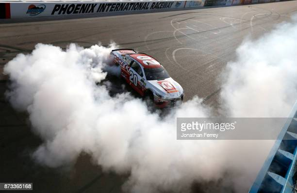 Matt Kenseth driver of the Circle K Toyota celebrates with a burnout after winning the Monster Energy NASCAR Cup Series CanAm 500 at Phoenix...