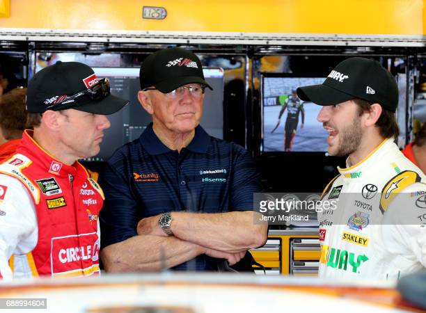 Matt Kenseth driver of the Circle K Toyota talk with Daniel Suarez driver of the Subway Toyota during practice for the Monster Energy NASCAR Series...