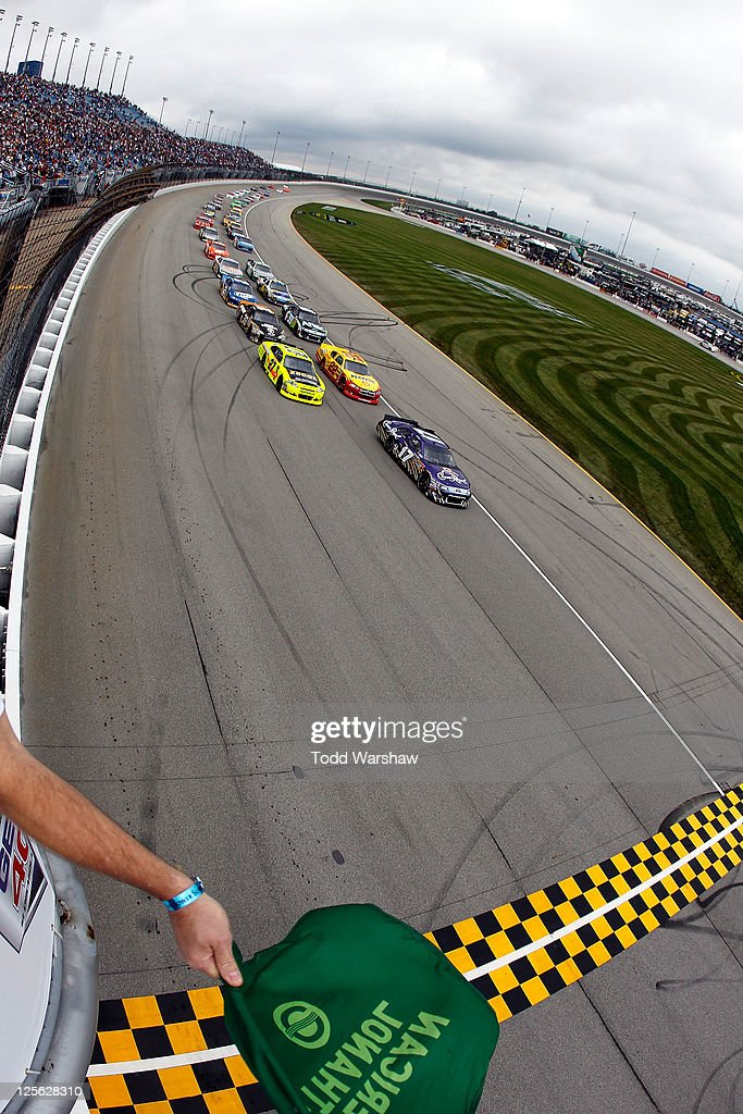 Matt Kenseth driver of the Crown Royal Ford and Paul Menard driver of the Zecol/Menards Chevrolet lead the field to the green flag to start the...