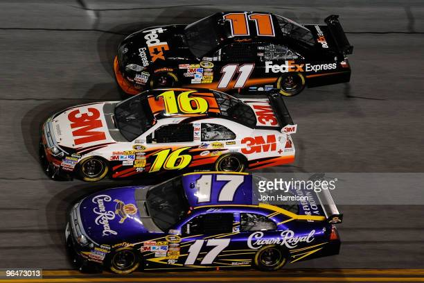Matt Kenseth driver of the Crown Royal Ford races Greg Biffle driver of the 3M Ford and Denny Hamlin Driver of the FedEx Express Toyota during the...