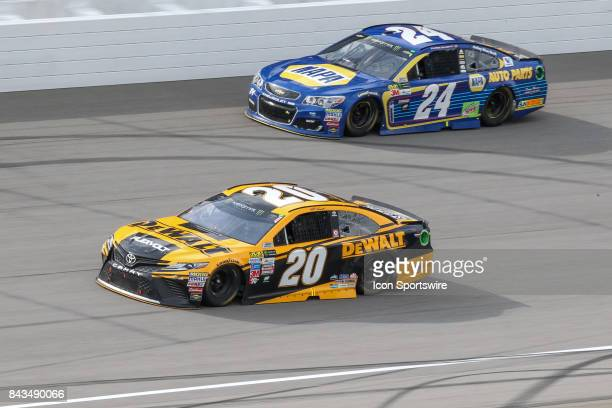 Matt Kenseth driver of the DEWALT Flexvolt Toyota and Chase Elliott driver of the NAPA Chevrolet race during the Monster Energy NASCAR Cup Series...