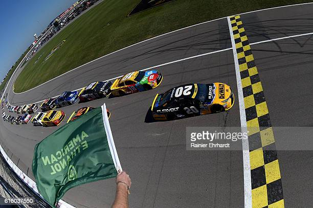 Matt Kenseth driver of the DEWALT FLEXVOLT Toyota and Kyle Busch driver of the MM's Toyota lead the field to the green flag to start the NASCAR...