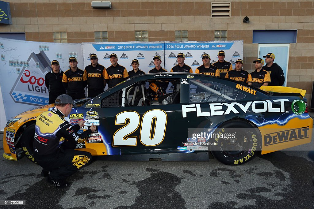 Matt Kenseth, driver of the #20 DEWALT FLEXVOLT Toyota, places the Coors Light Pole Award decal after qualifying in the pole position for the NASCAR Sprint Cup Series Hollywood Casino 400 at Kansas Speedway on October 14, 2016 in Kansas City, Kansas.