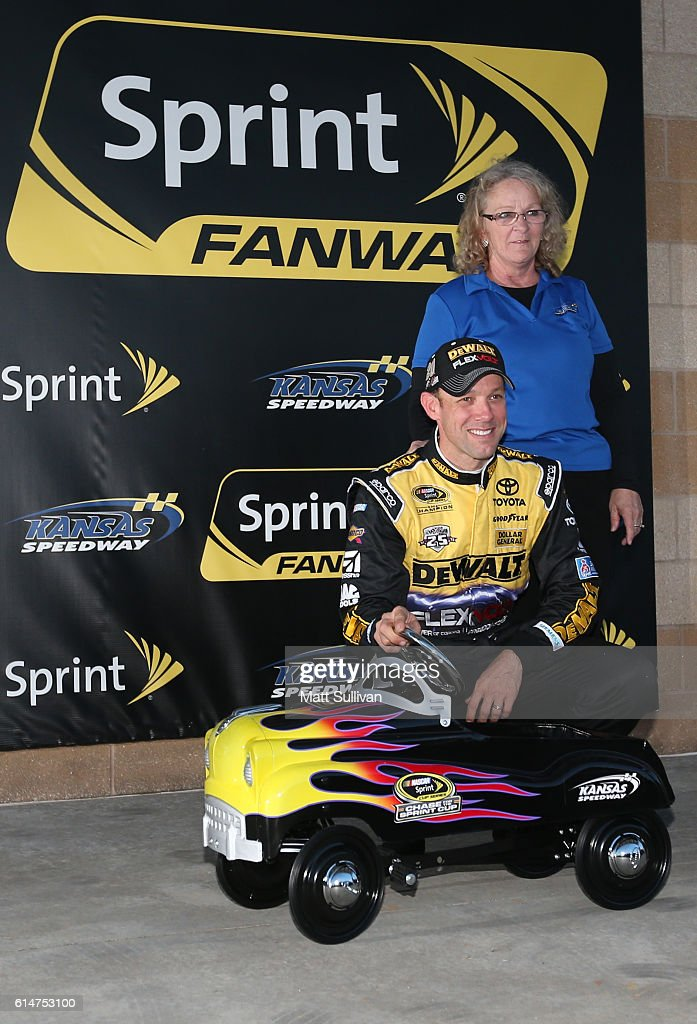 Matt Kenseth, driver of the #20 DEWALT FLEXVOLT Toyota, poses with the track pole award after qualifying in the pole position for the NASCAR Sprint Cup Series Hollywood Casino 400 at Kansas Speedway on October 14, 2016 in Kansas City, Kansas.