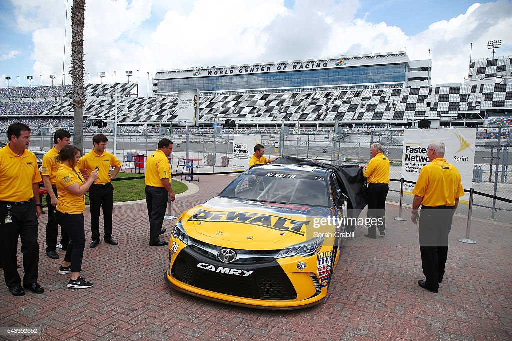 <a gi-track='captionPersonalityLinkClicked' href=/galleries/search?phrase=Matt+Kenseth&family=editorial&specificpeople=204192 ng-click='$event.stopPropagation()'>Matt Kenseth</a>, driver of the #20 DeWalt Toyota, and team owner <a gi-track='captionPersonalityLinkClicked' href=/galleries/search?phrase=Joe+Gibbs&family=editorial&specificpeople=171526 ng-click='$event.stopPropagation()'>Joe Gibbs</a> unveil the DeWalt sponsorship prior to practice for the NASCAR Sprint Cup Series Coke Zero 400 at Daytona International Speedway on June 30, 2016 in Daytona Beach, Florida.