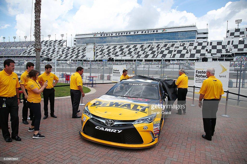 Matt Kenseth, driver of the #20 DeWalt Toyota, and team owner Joe Gibbs unveil the DeWalt sponsorship prior to practice for the NASCAR Sprint Cup Series Coke Zero 400 at Daytona International Speedway on June 30, 2016 in Daytona Beach, Florida.