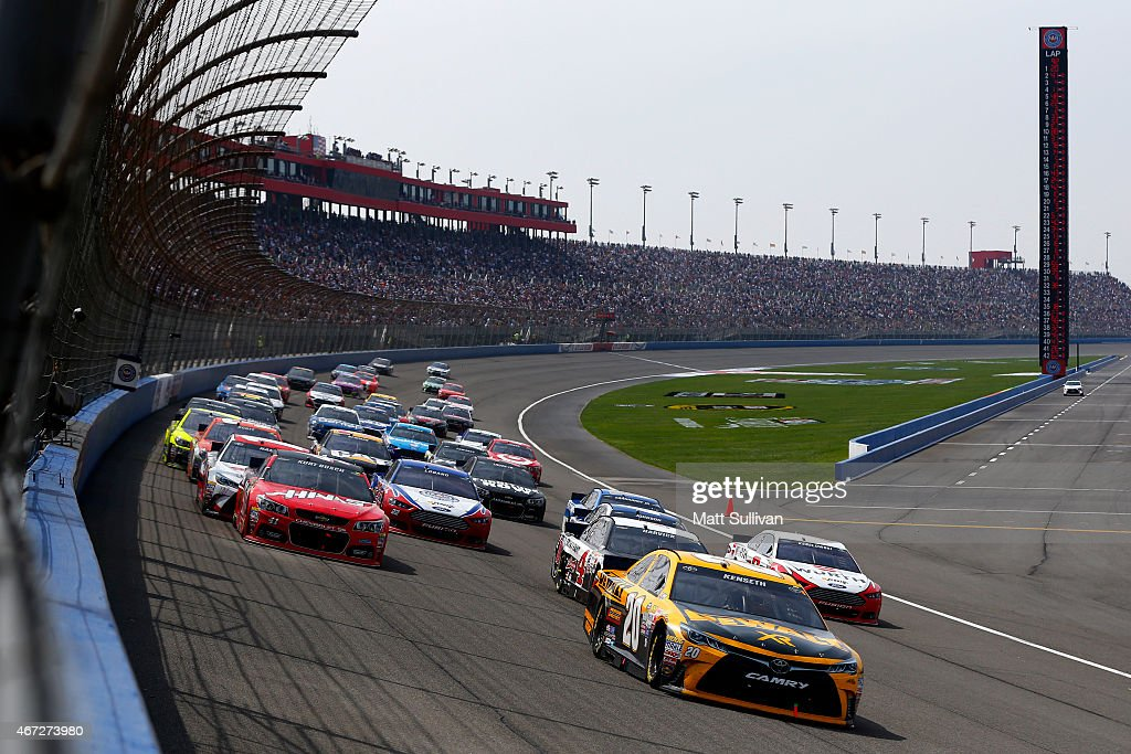 Matt Kenseth driver of the DeWalt Toyota leads the field after a restart during the NASCAR Sprint Cup Series Auto Club 400 at Auto Club Speedway on...