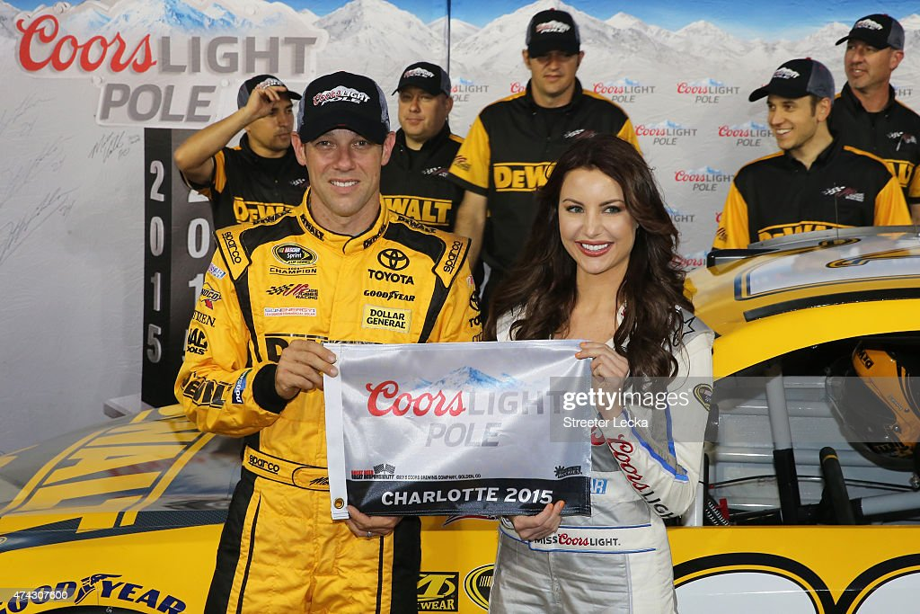 Matt Kenseth driver of the DeWalt Toyota poses with Miss Coors Light Amanda Mertz and the Coors Light Pole award after qualifying for pole position...
