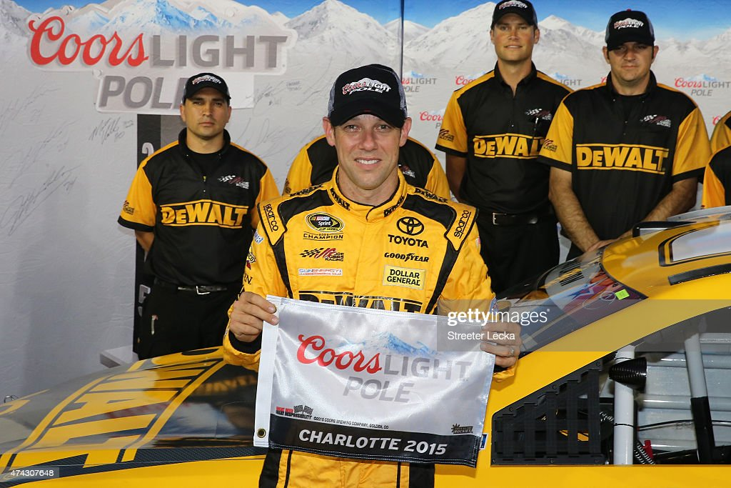 Matt Kenseth driver of the DeWalt Toyota poses with the Coors Light Pole Award after qualifying for pole position for the NASCAR Sprint Cup Series...