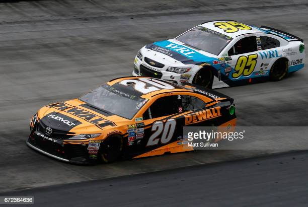 Matt Kenseth driver of the DeWalt Toyota races Michael McDowell driver of the WRL General Contractors Chevrolet during the Monster Energy NASCAR Cup...