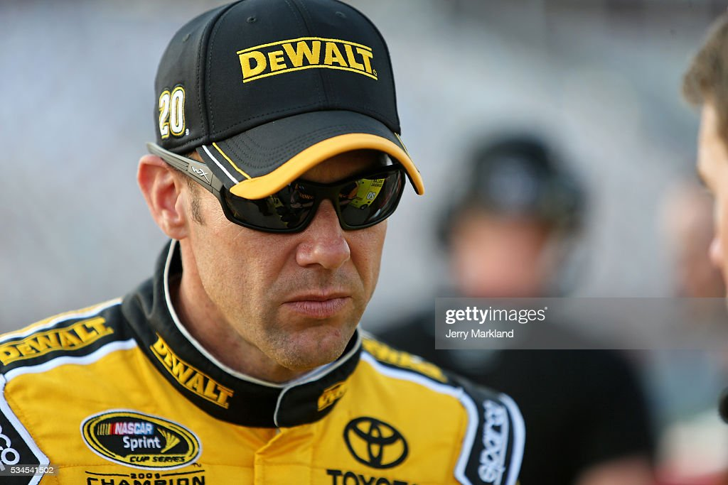 <a gi-track='captionPersonalityLinkClicked' href=/galleries/search?phrase=Matt+Kenseth&family=editorial&specificpeople=204192 ng-click='$event.stopPropagation()'>Matt Kenseth</a>, driver of the #20 DeWalt Toyota, stands on the grid during qualifying for the NASCAR Sprint Cup Series Coca-Cola 600 at Charlotte Motor Speedway on May 27, 2016 in Charlotte, North Carolina.