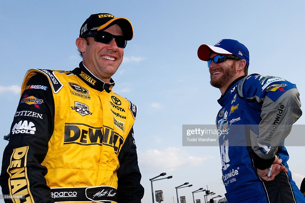 <a gi-track='captionPersonalityLinkClicked' href=/galleries/search?phrase=Matt+Kenseth&family=editorial&specificpeople=204192 ng-click='$event.stopPropagation()'>Matt Kenseth</a>, driver of the #20 DeWalt Toyota, talks to <a gi-track='captionPersonalityLinkClicked' href=/galleries/search?phrase=Dale+Earnhardt+Jr.&family=editorial&specificpeople=171293 ng-click='$event.stopPropagation()'>Dale Earnhardt Jr.</a>, driver of the #88 Nationwide Chevrolet, during qualifying for the NASCAR Sprint Cup Series Coca-Cola 600 at Charlotte Motor Speedway on May 27, 2016 in Charlotte, North Carolina.