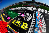 Matt Kenseth driver of the Dollar General Toyota and Kyle Busch driver of the MM's Pretty In Pink Foundation Toyota lead the field to the green flag...
