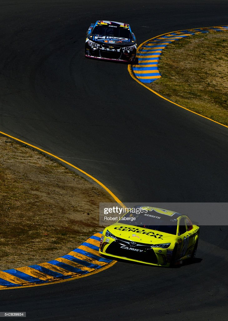 <a gi-track='captionPersonalityLinkClicked' href=/galleries/search?phrase=Matt+Kenseth&family=editorial&specificpeople=204192 ng-click='$event.stopPropagation()'>Matt Kenseth</a>, driver of the #20 Dollar General Toyota, and <a gi-track='captionPersonalityLinkClicked' href=/galleries/search?phrase=Regan+Smith&family=editorial&specificpeople=564271 ng-click='$event.stopPropagation()'>Regan Smith</a>, driver of the #7 Nikko RC/Road Rippers Monster Shark Chevrolet, during practice for the NASCAR Sprint Cup Series Toyota/Save Mart 350 at Sonoma Raceway on June 24, 2016 in Sonoma, California.