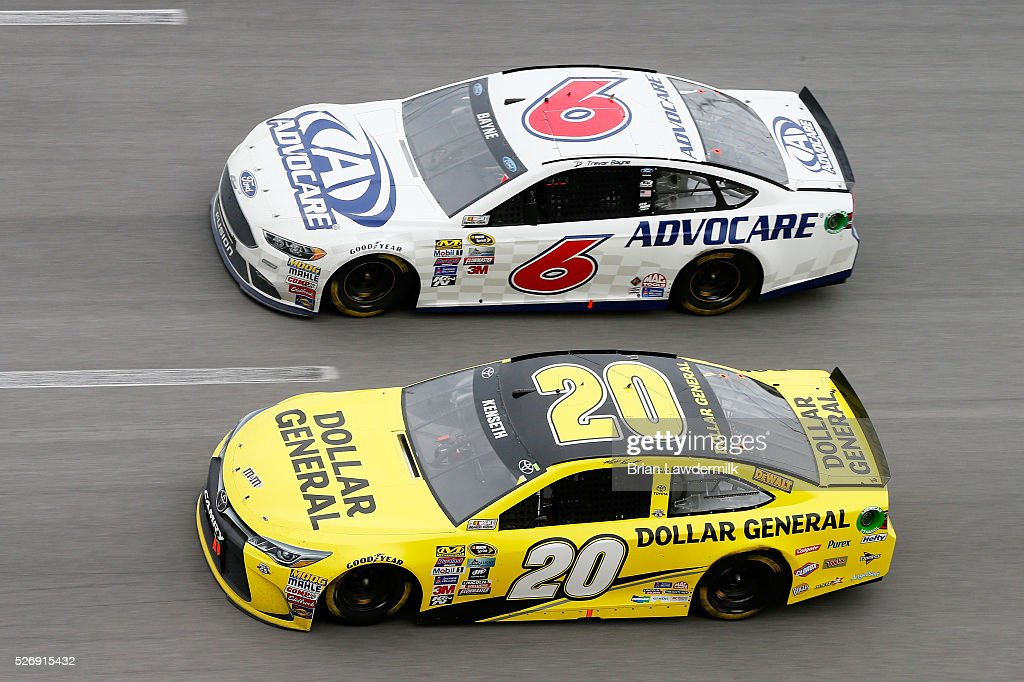 Matt Kenseth, driver of the #20 Dollar General Toyota, and Trevor Bayne, driver of the #6 AdvoCare Ford, race during the NASCAR Sprint Cup Series GEICO 500 at Talladega Superspeedway on May 1, 2016 in Talladega, Alabama.