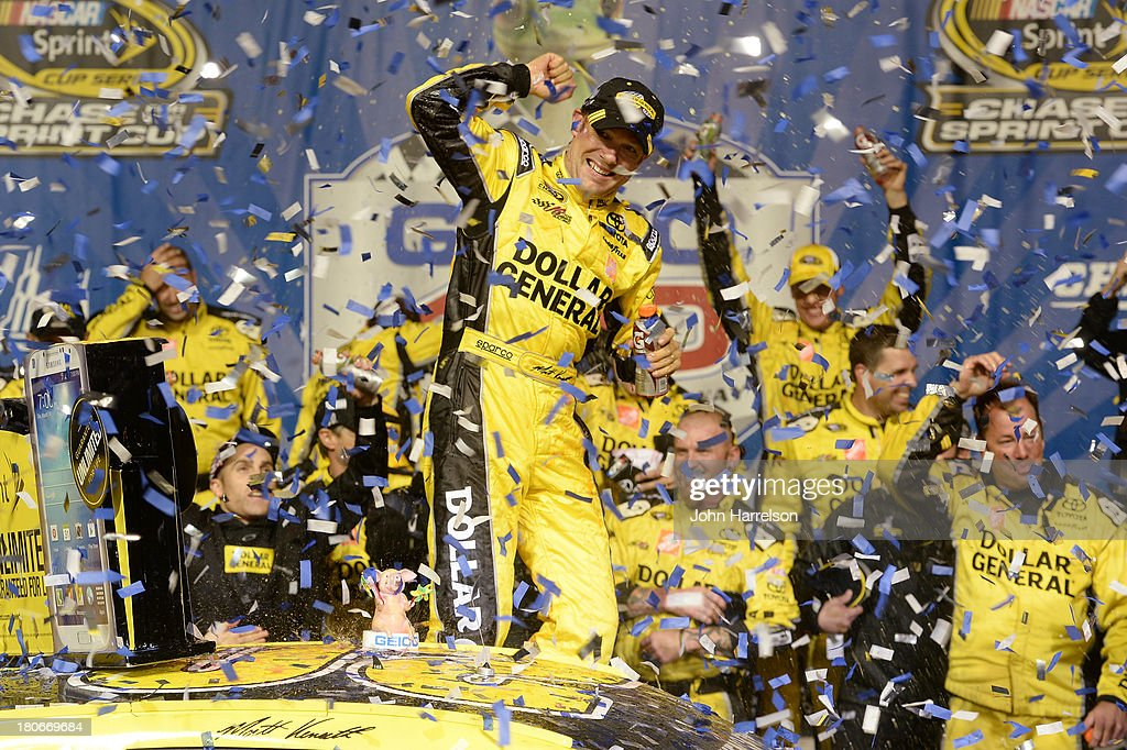 <a gi-track='captionPersonalityLinkClicked' href=/galleries/search?phrase=Matt+Kenseth&family=editorial&specificpeople=204192 ng-click='$event.stopPropagation()'>Matt Kenseth</a>, driver of the #20 Dollar General Toyota, celebrates in victory lane after winning the NASCAR Sprint Cup Series Geico 400 at Chicagoland Speedway on September 15, 2013 in Joliet, Illinois.