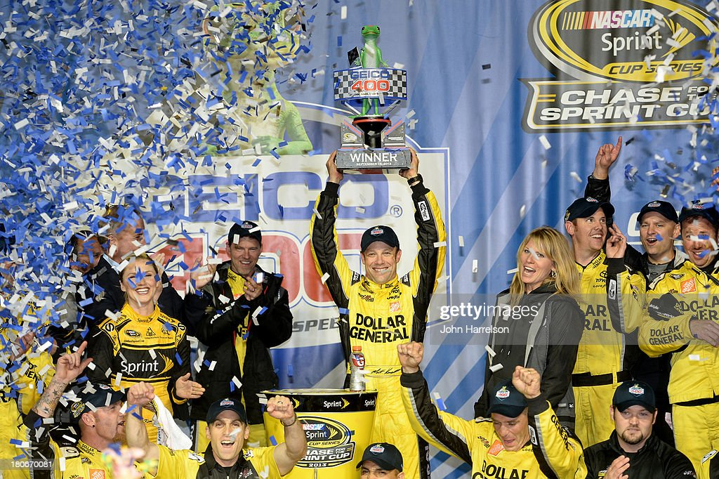 Matt Kenseth, driver of the #20 Dollar General Toyota, celebrates in victory lane after winning the NASCAR Sprint Cup Series Geico 400 at Chicagoland Speedway on September 15, 2013 in Joliet, Illinois.