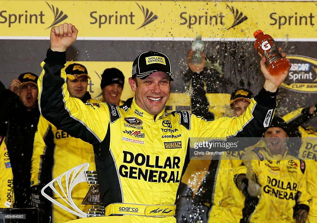 Matt Kenseth driver of the Dollar General Toyota celebrates in victory lane after winning the 3rd Annual Sprint Unlimited at Daytona at Daytona...