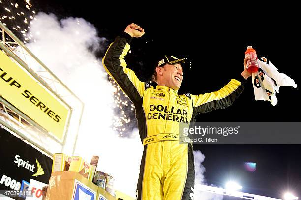 Matt Kenseth driver of the Dollar General Toyota celebrates in Victory Lane after winning the NASCAR Sprint Cup Series Food City 500 at Bristol Motor...