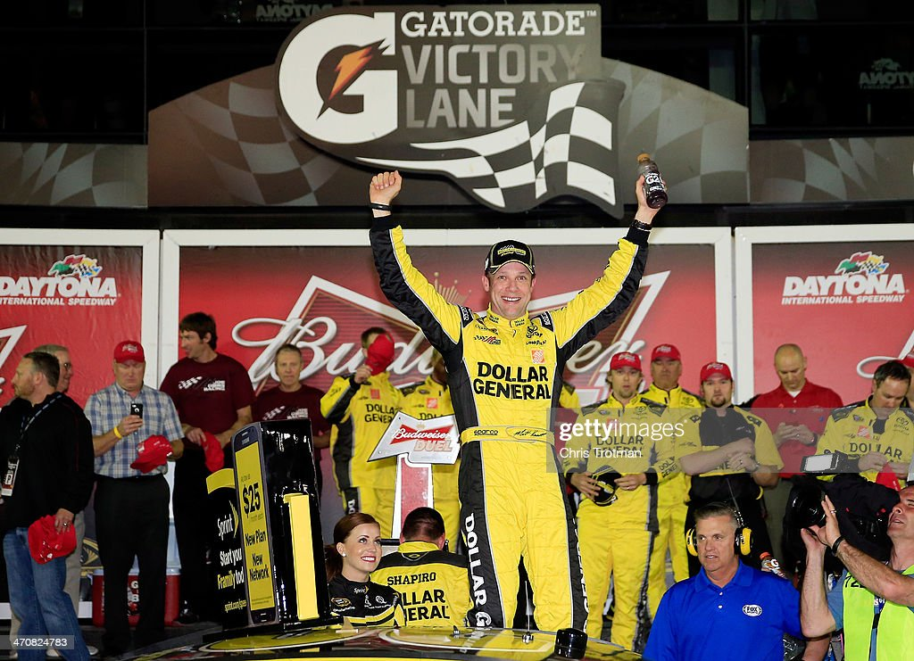 <a gi-track='captionPersonalityLinkClicked' href=/galleries/search?phrase=Matt+Kenseth&family=editorial&specificpeople=204192 ng-click='$event.stopPropagation()'>Matt Kenseth</a>, driver of the #20 Dollar General Toyota, celebrates in Victory Lane after winning the NASCAR Sprint Cup Series Budweiser Duel 1 at Daytona International Speedway on February 20, 2014 in Daytona Beach, Florida.