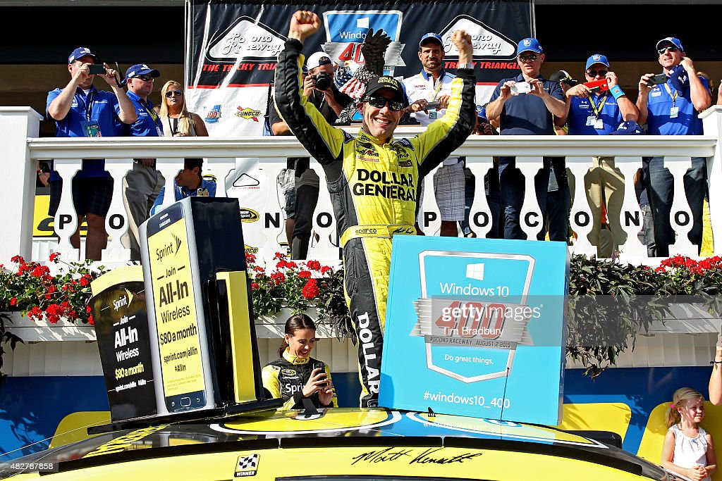 <a gi-track='captionPersonalityLinkClicked' href=/galleries/search?phrase=Matt+Kenseth&family=editorial&specificpeople=204192 ng-click='$event.stopPropagation()'>Matt Kenseth</a>, driver of the #20 Dollar General Toyota, celebrates in Victory Lane after winning the NASCAR Sprint Cup Series Windows 10 400 at Pocono Raceway on August 2, 2015 in Long Pond, Pennsylvania.