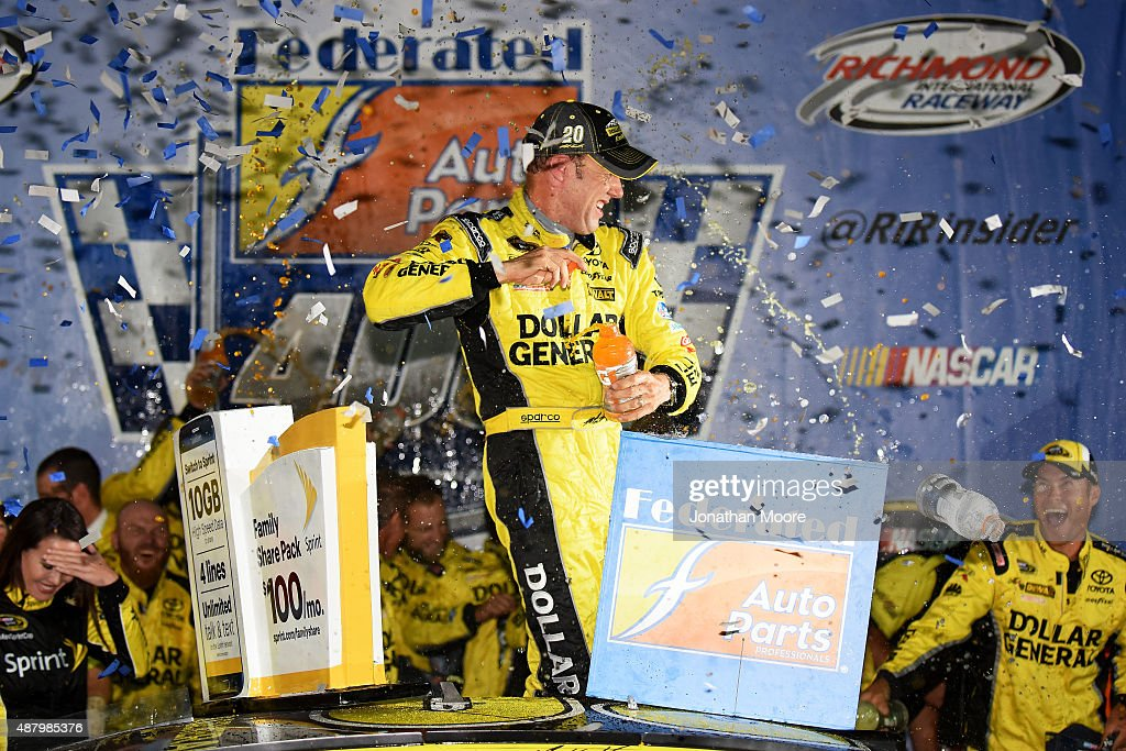 Matt Kenseth driver of the Dollar General Toyota celebrates in Victory Lane after winning the NASCAR Sprint Cup Series Federated Auto Parts 400 at...