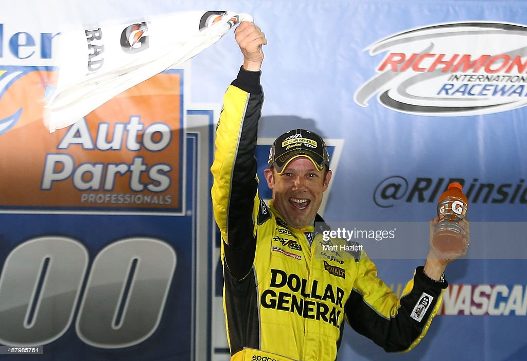 Matt Kenseth, driver of the #20 Dollar General Toyota, celebrates in Victory Lane after winning the NASCAR Sprint Cup Series Federated Auto Parts 400 at Richmond International Raceway on September 12, 2015 in Richmond, Virginia.