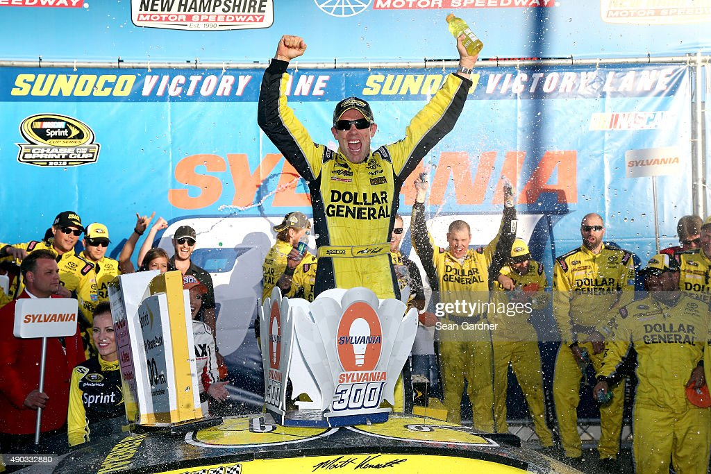<a gi-track='captionPersonalityLinkClicked' href=/galleries/search?phrase=Matt+Kenseth&family=editorial&specificpeople=204192 ng-click='$event.stopPropagation()'>Matt Kenseth</a>, driver of the #20 Dollar General Toyota, celebrates in Victory Lane after winning the NASCAR Sprint Cup Series SYLVANIA 300 at New Hampshire Motor Speedway on September 27, 2015 in Loudon, New Hampshire.