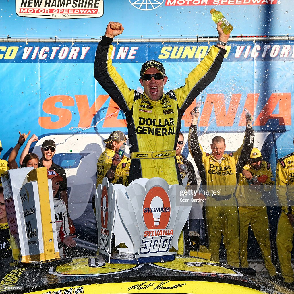 Matt Kenseth driver of the Dollar General Toyota celebrates in Victory Lane after winning the NASCAR Sprint Cup Series SYLVANIA 300 at New Hampshire...