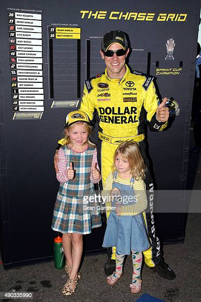 Matt Kenseth driver of the Dollar General Toyota celebrates in Victory Lane with his daughters Kaylin and Grace after winning the NASCAR Sprint Cup...