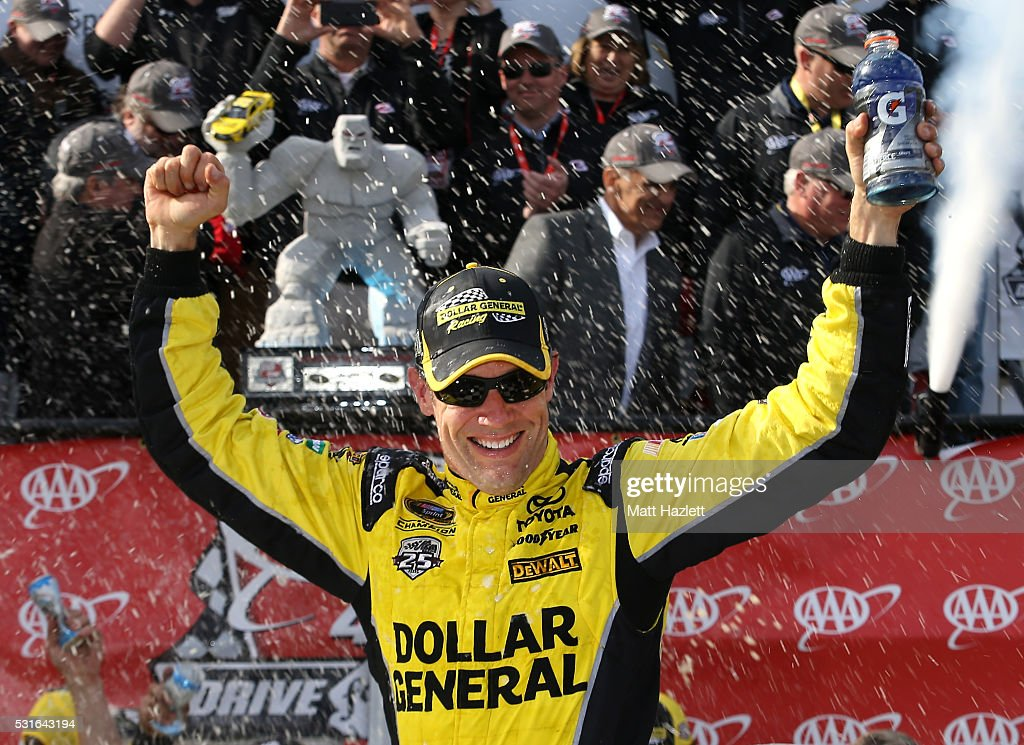 <a gi-track='captionPersonalityLinkClicked' href=/galleries/search?phrase=Matt+Kenseth&family=editorial&specificpeople=204192 ng-click='$event.stopPropagation()'>Matt Kenseth</a>, driver of the #20 Dollar General Toyota, celebrates in Victory Lane after winning the NASCAR Sprint Cup Series AAA 400 Drive for Autism at Dover International Speedway on May 15, 2016 in Dover, Delaware.