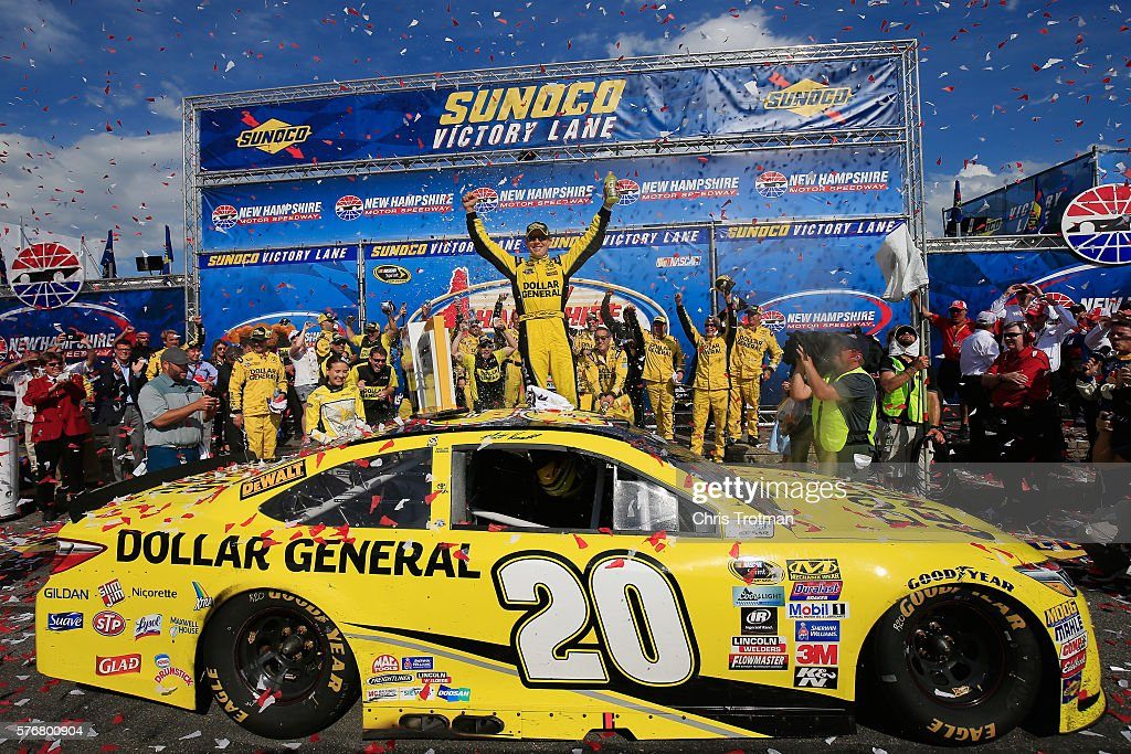 Matt Kenseth, driver of the #20 Dollar General Toyota, celebrates in Victory Lane after winning the NASCAR Sprint Cup Series New Hampshire 301 at New Hampshire Motor Speedway on July 17, 2016 in Loudon, New Hampshire.