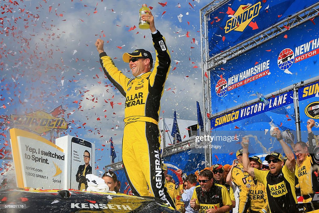 Matt Kenseth driver of the Dollar General Toyota celebrates in Victory Lane after winning the NASCAR Sprint Cup Series New Hampshire 301 at New...