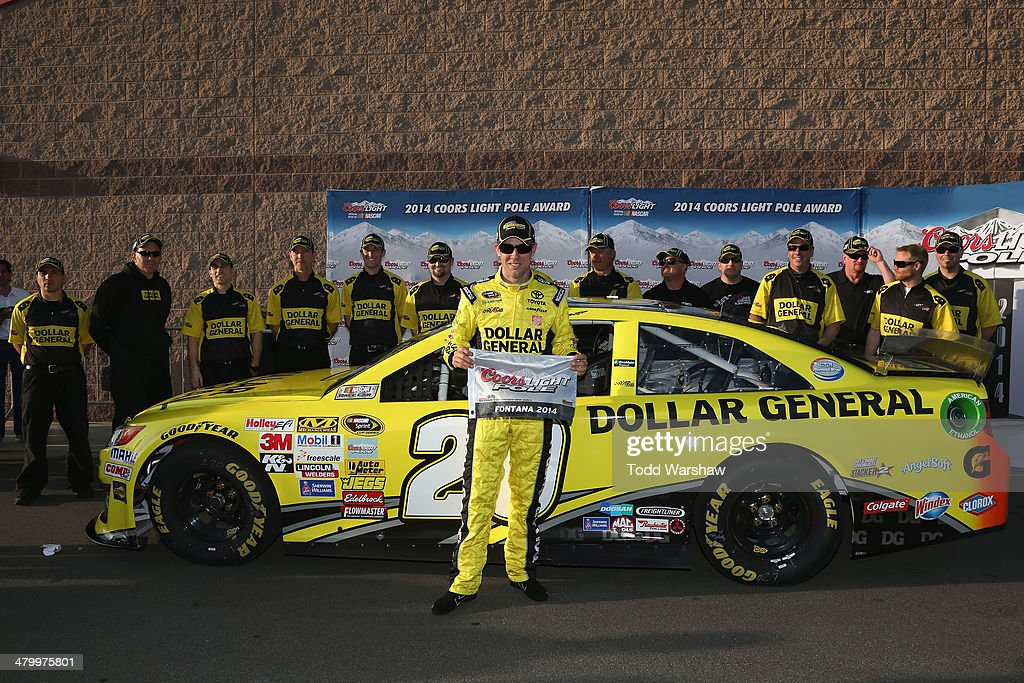 <a gi-track='captionPersonalityLinkClicked' href=/galleries/search?phrase=Matt+Kenseth&family=editorial&specificpeople=204192 ng-click='$event.stopPropagation()'>Matt Kenseth</a>, driver of the #20 Dollar General Toyota, celebrates setting the pole position in qualifying for the NASCAR Sprint Cup Series Auto Club 400 at Auto Club Speedway on March 21, 2014 in Fontana, California.